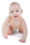 Bebé en el arrastre del pañal fotos de archivo