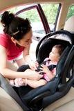 Bebé en el asiento de coche para la seguridad Imágenes de archivo libres de regalías
