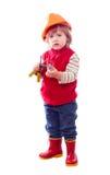 Bebé en el casco de protección con las herramientas Foto de archivo