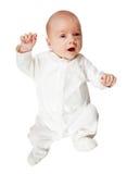 Bebé en el mameluco blanco sobre blanco Fotografía de archivo libre de regalías