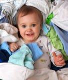 Bebé en el montón del desgaste Fotografía de archivo libre de regalías
