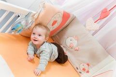 Bebé en el pesebre Fotos de archivo