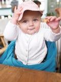 Bebé en el vector en restaurante Imagen de archivo libre de regalías