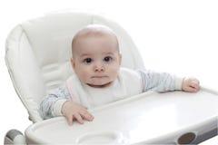 Bebé en highchair imagenes de archivo
