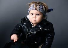 Bebé en la chaqueta de cuero Imagen de archivo