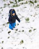 Bebé en la primera nieve Fotografía de archivo libre de regalías
