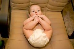 Bebé en la silla foto de archivo libre de regalías
