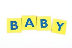 Bebé en letras de molde Imágenes de archivo libres de regalías