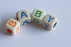 Bebé en letras de molde Imagen de archivo