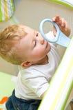 Bebé en playpen Foto de archivo libre de regalías