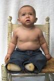Bebé en silla Fotografía de archivo