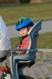 Bebé en silla de la bicicleta Imágenes de archivo libres de regalías