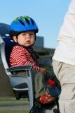 Bebé en silla de la bicicleta Imagen de archivo libre de regalías