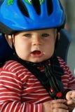 Bebé en silla de la bicicleta Fotografía de archivo