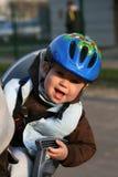 Bebé en silla de la bicicleta Fotos de archivo