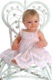 Bebé en silla de mimbre Fotografía de archivo