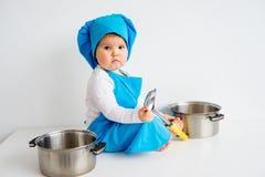 Bebé en sombrero del cocinero Fotos de archivo libres de regalías