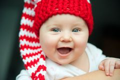 Bebé en sombrero rojo Foto de archivo