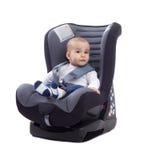 Bebé en un asiento de coche Imagenes de archivo