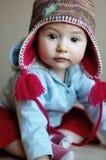 Bebé en un casquillo divertido Foto de archivo libre de regalías