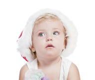 Bebé en un casquillo rojo del Año Nuevo Imagenes de archivo