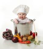 Bebé en un crisol de cocinar Fotos de archivo