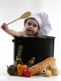 Bebé en un crisol del cocinero Imágenes de archivo libres de regalías