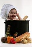 Bebé en un crisol del cocinero Foto de archivo