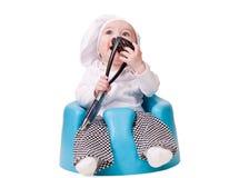 Bebé en un equipo del cocinero Imagen de archivo libre de regalías