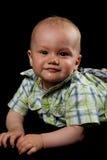 Bebé en un fondo negro Imagen de archivo