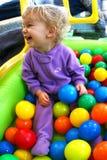 Bebé en un hueco de la bola Imagen de archivo libre de regalías