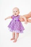 Bebé en una alineada Imagenes de archivo