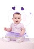 Bebé en una alineada púrpura Fotografía de archivo