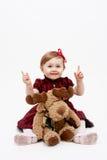 Bebé feliz con el juguete de la Navidad del reno Imagenes de archivo
