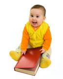 Bebé feliz con el libro Imagen de archivo libre de regalías