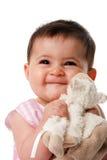 Bebé feliz con la manta de seguridad Imagenes de archivo