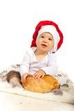 Bebé feliz del cocinero con pan Imagen de archivo libre de regalías