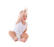 Bebé feliz divertido aislado en blanco Foto de archivo