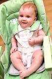Bebé feliz en alta silla Foto de archivo