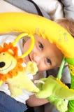 Bebé feliz en cochecito Imagen de archivo