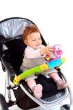 Bebé feliz en cochecito Fotos de archivo