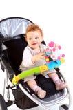 Bebé feliz en cochecito Imagenes de archivo