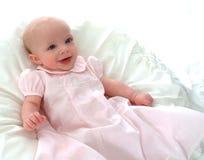 Bebé feliz en color de rosa Imagen de archivo libre de regalías