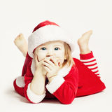 Bebé feliz en el sombrero de Santa Niño de risa Imágenes de archivo libres de regalías