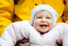 Bebé feliz en manos de los padres Fotografía de archivo