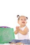 Bebé feliz que aplaude con el ABC Fotografía de archivo