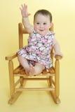 Bebé feliz que levanta la mano Imagen de archivo libre de regalías