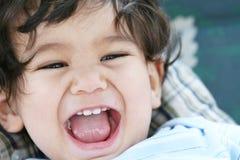 Bebé feliz y animado Fotografía de archivo libre de regalías