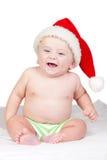 Bebé hermoso con los ojos azules y el sombrero de la Navidad fotografía de archivo libre de regalías