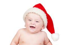 Bebé hermoso con los ojos azules y el sombrero de la Navidad imágenes de archivo libres de regalías